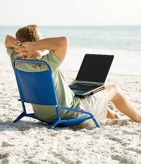 Man on beach with computer.jpg